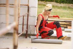 Free Woman Installing Pipes On Construction Site Royalty Free Stock Images - 159256819