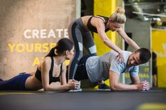 Female coach is training couple in sport center Stock Images