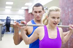 Woman with instructor in gym Royalty Free Stock Photography