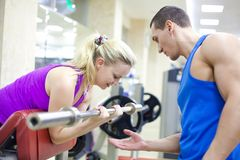 Woman with instructor in gym Royalty Free Stock Image