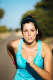 Woman intense running Stock Photos
