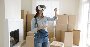 Woman interacting with her virtual environment Stock Photos