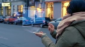 Woman interacts HUD hologram with modern smartphone stock video