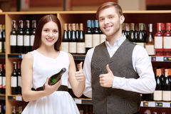 Woman interacts with a sommelier in shop Stock Image
