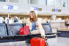Woman at international airport waiting for flight at terminal Stock Photography