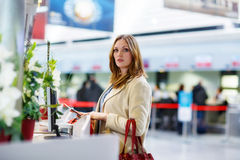 Woman at international airport waiting for flight Royalty Free Stock Photography