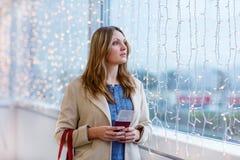 Woman at international airport waiting for flight Royalty Free Stock Photos