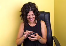 Woman on the Internet. Woman amused by what she is seeing on the internet royalty free stock photos