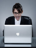 Woman internet dating. Beautiful young caucasian woman surfing for love on the internet Stock Image