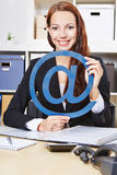 Woman with internet sign in office Stock Image