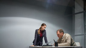 Woman Interrogating Suspect in Crime Royalty Free Stock Photo