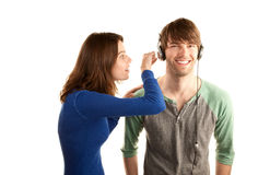 Woman interupts man with headphones Stock Photos