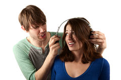 Woman interupts man with headphones Stock Photo