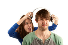 Woman interupts man with headphones Stock Photo
