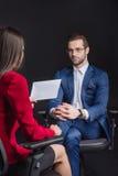 Woman interviewing man Stock Photo