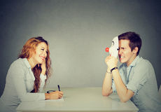 Woman interviewing new candidate for a job, a man pretender hiding his real personality Stock Images