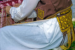 Woman interweaves by hand Romanian traditional dress Royalty Free Stock Images
