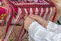 Woman interweaves by hand Romanian traditional dress Royalty Free Stock Photography