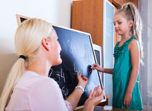 Woman introducing numbers to girl Royalty Free Stock Image