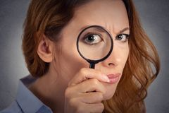 Woman investigator looking through magnifying glass. Headshot, closeup portrait of woman investigator looking through magnifying glass royalty free stock photos
