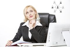 Woman Investigator thinking. Sitting on desk royalty free stock photography