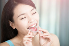 Woman with invisible braces Stock Photography