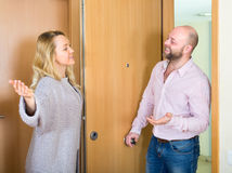 Woman invites man to come in Stock Photography