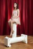 Woman on Ionic pillar Stock Photo