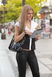 Woman with ipad tablet computer on street Stock Photography