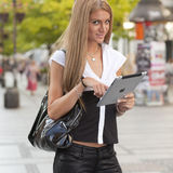 Woman with iPad tablet on street Stock Photography