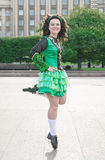 Woman in irish dance dress dancing Stock Images