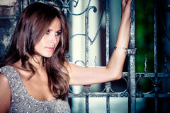 woman by the iron gate portrait royalty free stock images