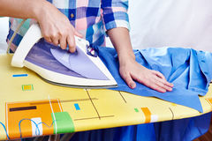 Woman ironed men's shirt Royalty Free Stock Photo