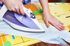 Woman ironed men's shirt Stock Images