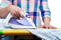 Woman ironed shirt Royalty Free Stock Photography