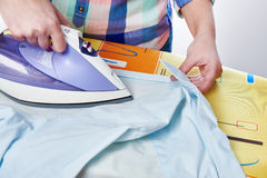 Woman ironed shirt Royalty Free Stock Photo