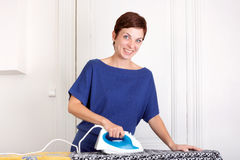 Woman ironing Royalty Free Stock Photo