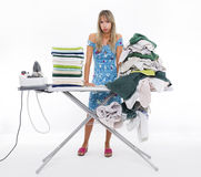 Woman ironing on board many clothing Royalty Free Stock Photos