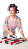 Woman is ironing clother Stock Images