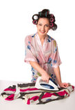 Woman is ironing clother Stock Image