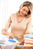 Woman ironing clothes Stock Photos