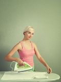 Woman ironing clothes Stock Image