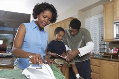 Woman Ironing Clothes At Home royalty free stock photography