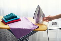 Woman Ironing clothes at home. Close up royalty free stock image
