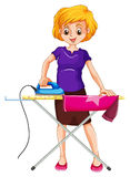 Woman ironing clothes on the ironing board Royalty Free Stock Images