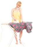 Woman ironing clothes  and speaking on the phone Royalty Free Stock Images