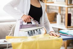 Woman Ironing Clothes With Steam From Iron Stock Photos