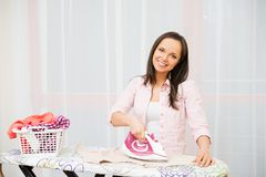 Woman ironing clothes Royalty Free Stock Images