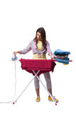 The woman ironing clothing isolated on white Royalty Free Stock Images