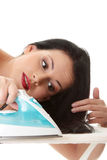 Woman ironing her hairs Royalty Free Stock Photos